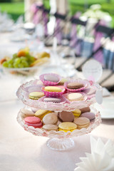 Colorful macarons cookies at the served festive table