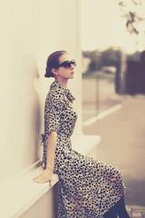 Fashion vintage style - beautiful elegant woman in leopard dress