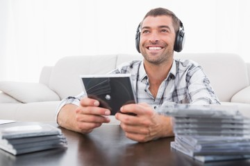 A man listening to cds