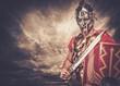 Legionary soldier against stormy sky