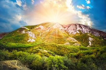 Beautiful summer sunset over the mountain valley