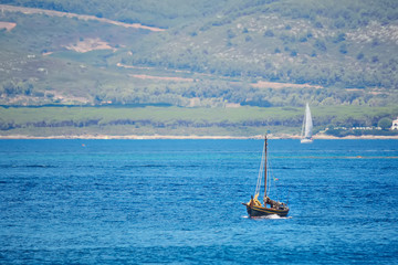 brown boat in the blue sea