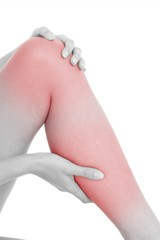 Closeup mid section of a woman with leg pain