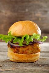 Vegetarian lentil burger in wholewheat bun with lettuce