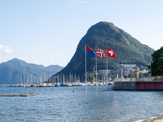 Lake Lugano, Monte San Salvatore ,and the flags of Switzerland,