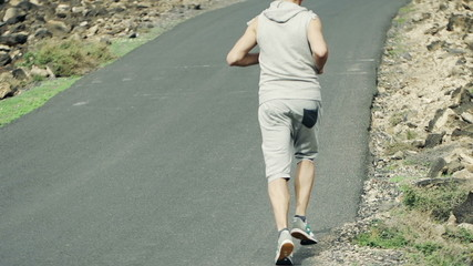 Man jogging up through road, slow motion shot at 240fps