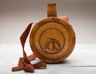 Old wooden bottle on wooden background