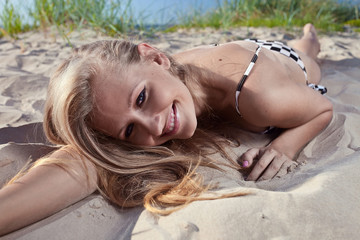 young beautiful woman on a bech