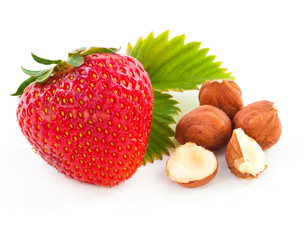 beautiful delicious strawberry with leaf and nuts on white backg