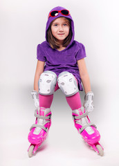 Portrait of emotional sports  kid with roller skate