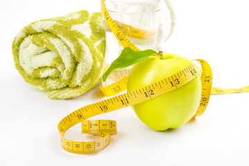 Apple core, towel, bottled water for healthy life over a white b