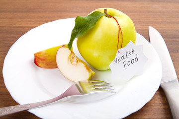 dieting and health food. Yellow, green apple with leaf and white