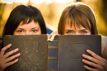 :Two girls and book