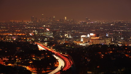 A timelapse view over Los Angeles at night with the lights of ex
