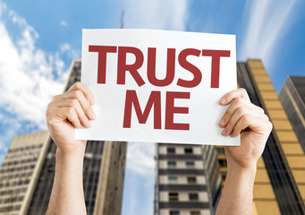 Trust Me card with a urban background