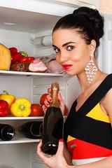 brunette woman and a fridge