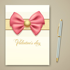 Valentines greeting card pink ribbon and pen