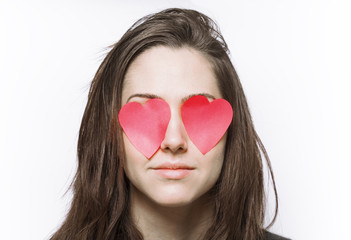 Girl with heart-shaped post-its on her eyes