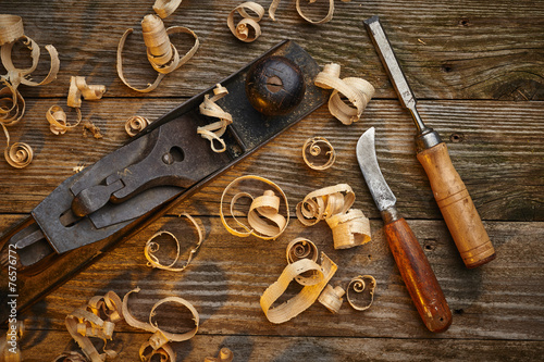 old tools on a work bench - 76576772