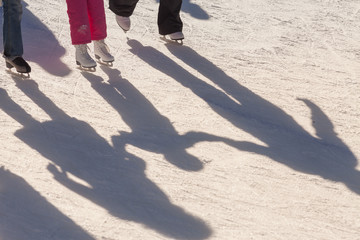 shadow background of family on the ice rink