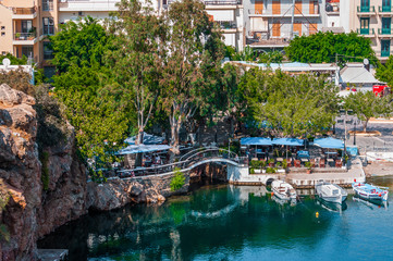 Small blue taverna with bridge near lake of Aghios Nikolaos