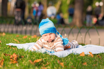 Cute little baby lying in the park