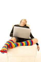 woman bright socks asleep with laptop
