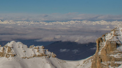 Sasso Lungo north col in winter, clouds in valley  Dolomite Alps