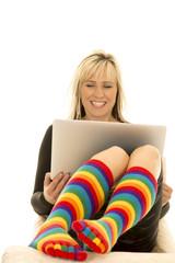 woman bright socks smile at computer