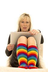 woman bright socks look shocked over computer