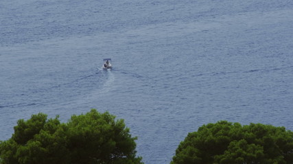 Panorama of Cavtat waters with boat passing by
