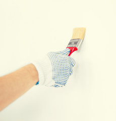 hand coloring wall with paintbrush