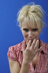 woman sucking her finger