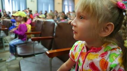 Little girl emotionally surprised