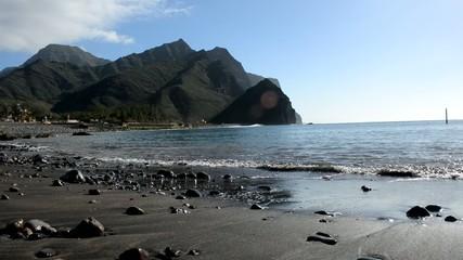 Tropical beach with black sand