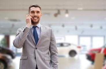 smiling businessman talking on smartphone