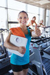 smiling woman with scales and towel in gym