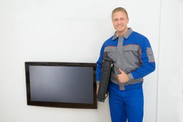 Portrait Of Technician Holding Amplifier