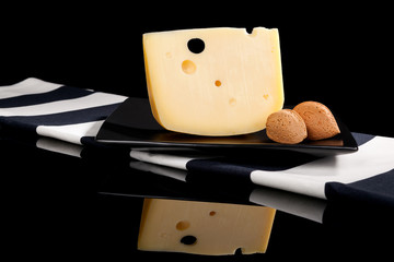 Luxurious emmental cheese still life.
