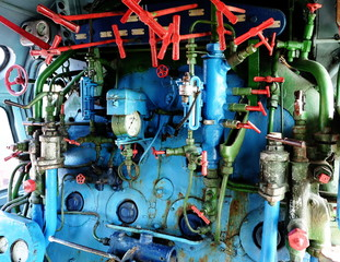 Steam engine with pipes, tubes, valve and gauges