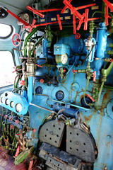 Steam engine with pipes and gauges from steam locomotive