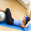 Woman doing exercises with fit ball