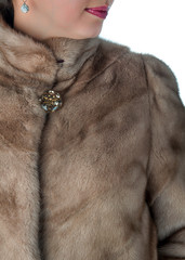 Fragment of female mink fur coats