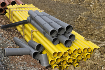 Stacks of colored pvc pipes