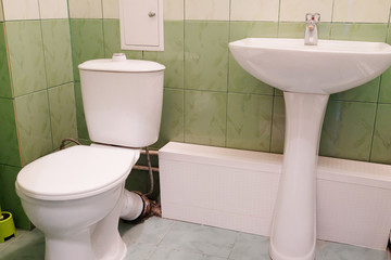 image of toilet and sink in a WC bathroom