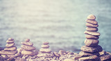 Vintage retro hipster style image of stones on beach, spa concep - 76589977