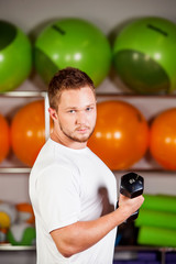 Dumbbell men at gym workout biceps fitness weightlifting