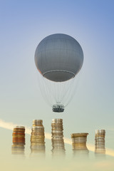 Gas Balloon and Stakes of Coins against the Sky