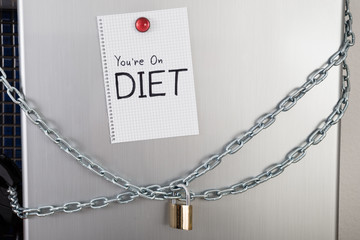 Note With Diet Text On Locked Fridge