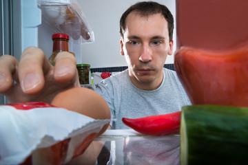Man Taking Egg From Fridge